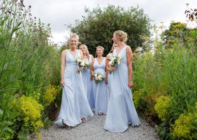 bridesmaids walking and laughing
