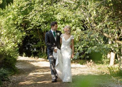 Bride and groom walking in Pentre Halkyn
