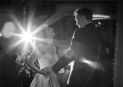 bride and groom dancing with a starburst of light in the backgrouns at Chester Racecourse