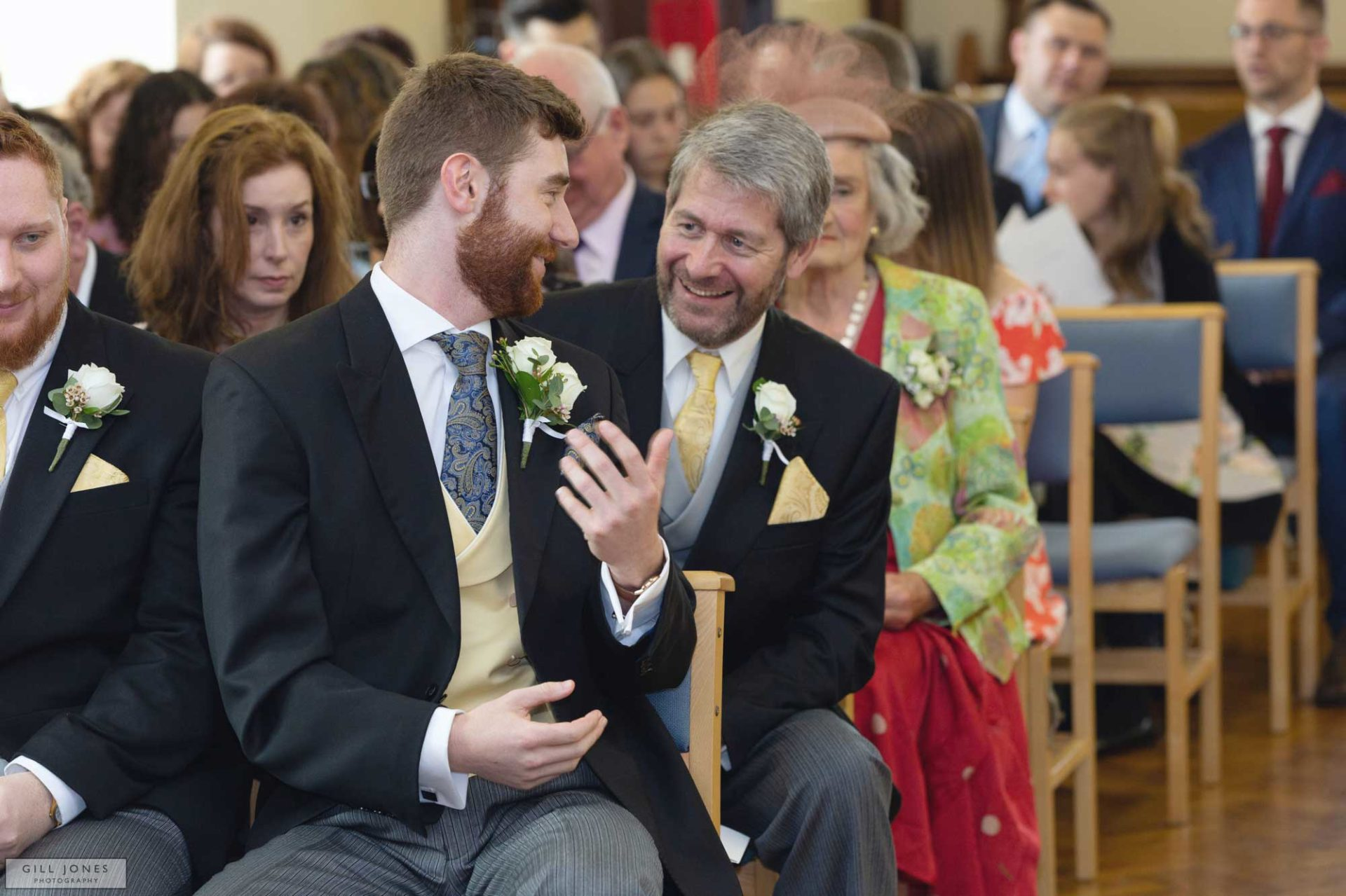 a father and groom are exchanging words at this north wales wedding