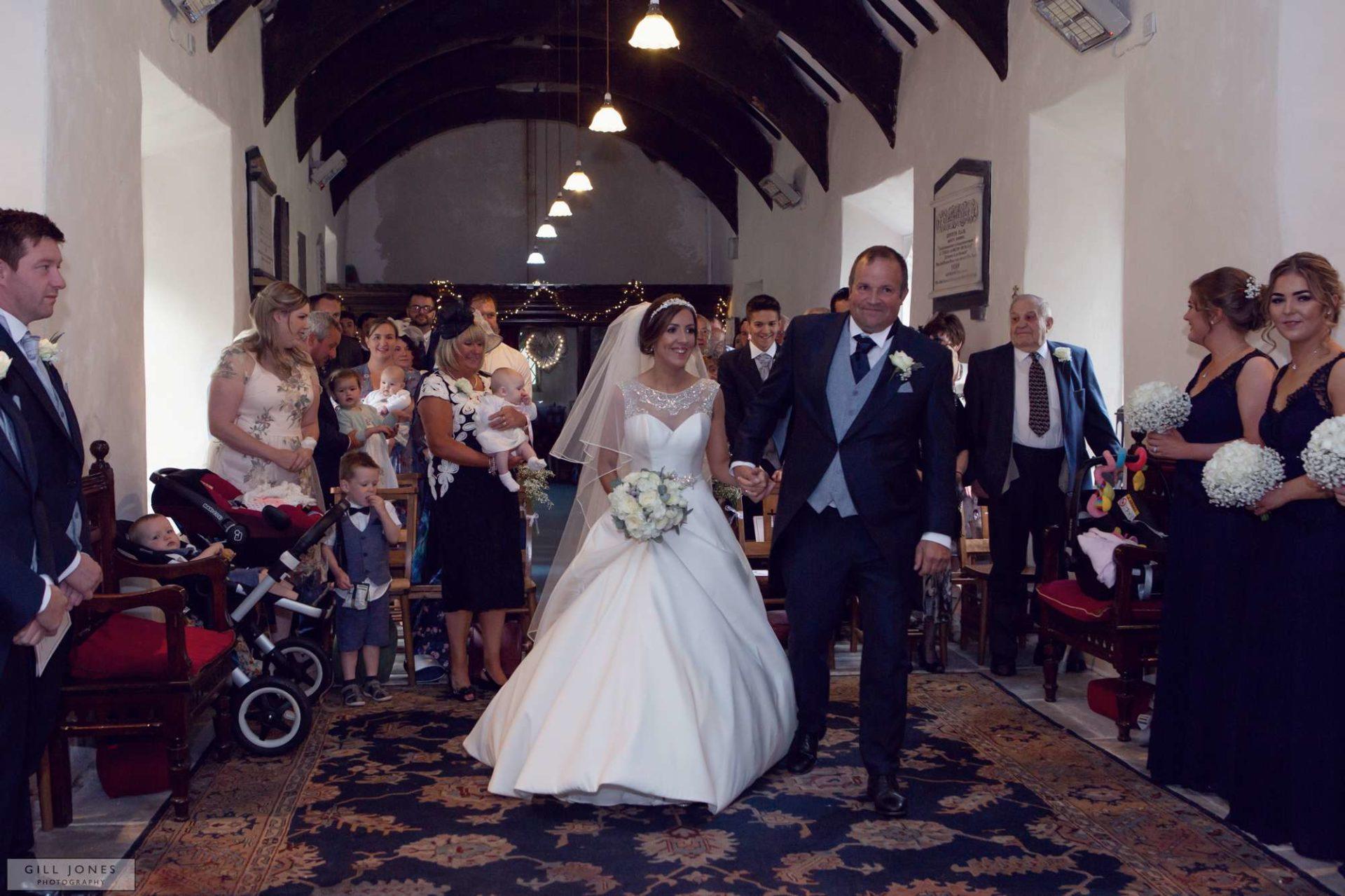 the bride walking towards the groom