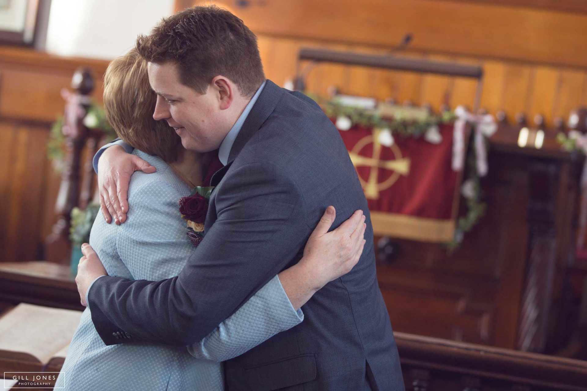 the groom hugs his mother