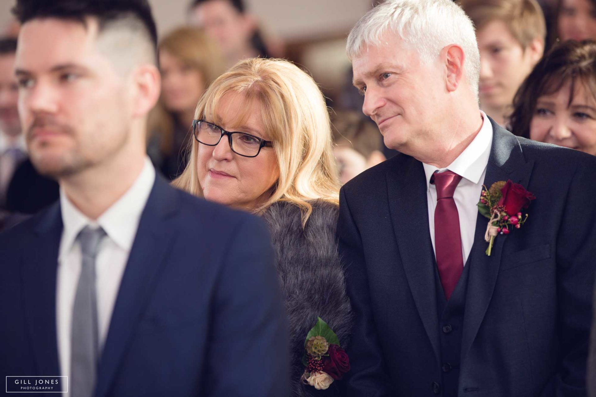 mum and Dad look on