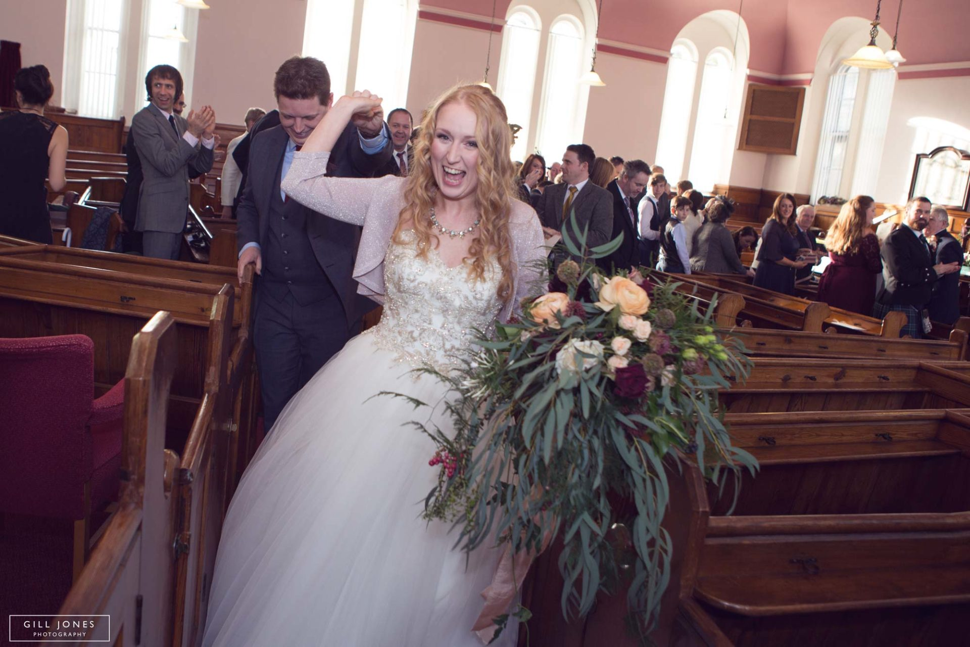 the bride leading the groom out of chapel