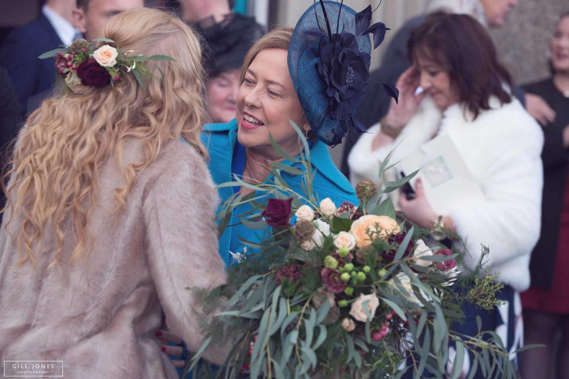 a guests hugging the bride