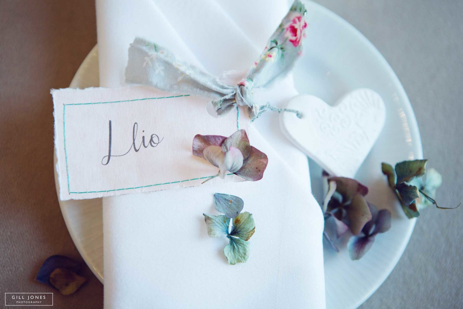 a napkin and ribbon on a side plate