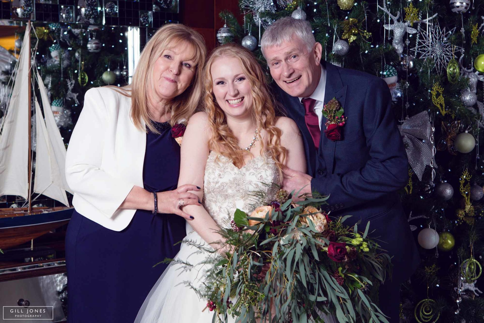 the bride with her mum and dad