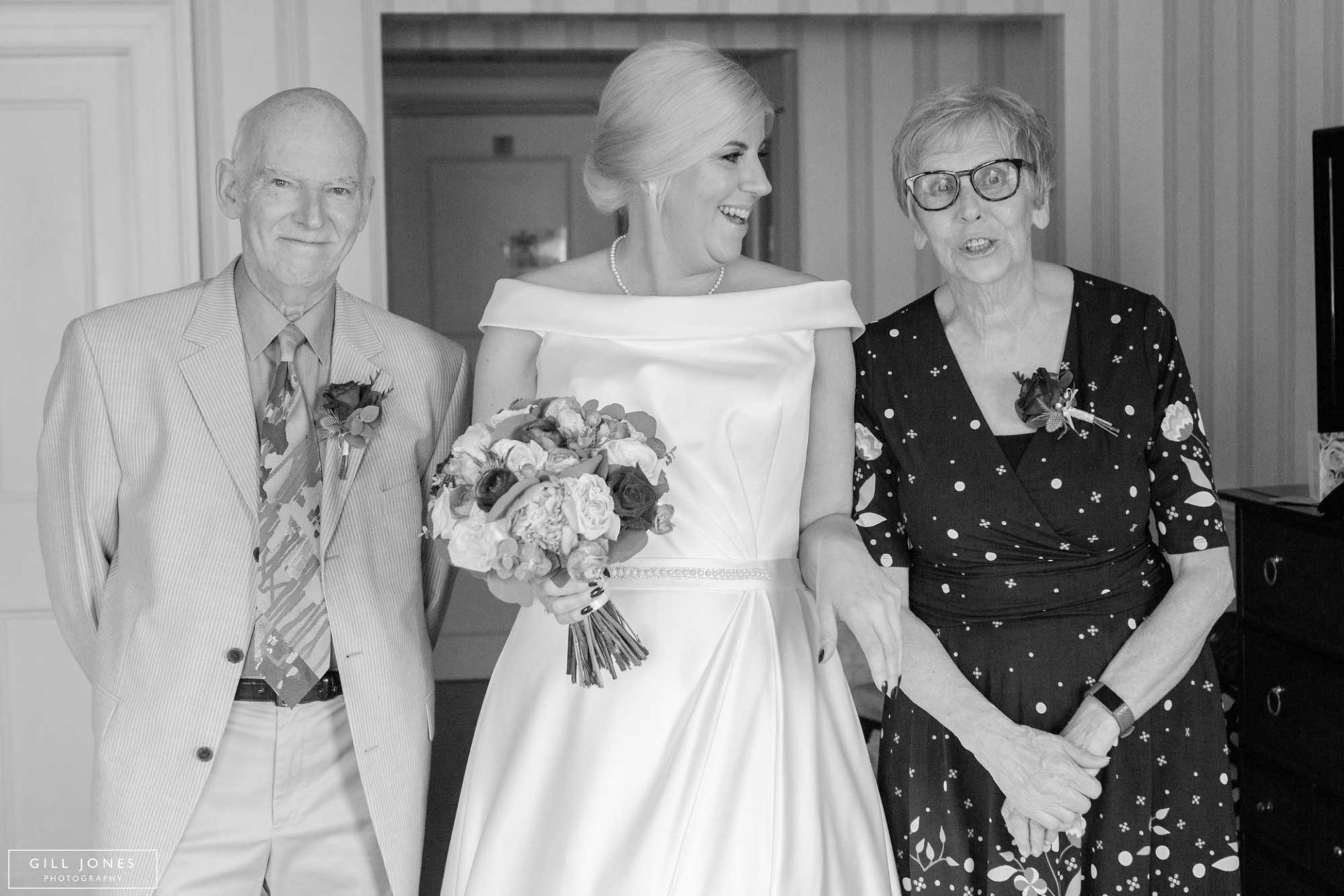 the bride with her parents having a giggle