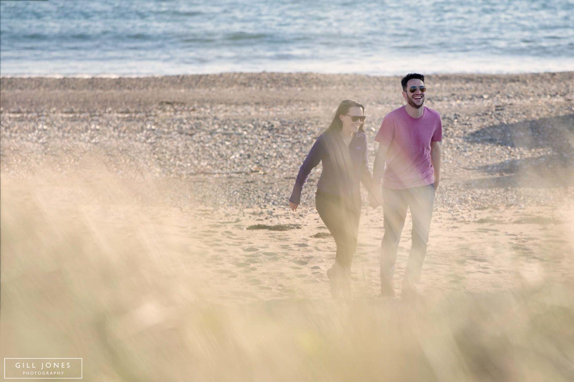 a couple walking through the seagrass