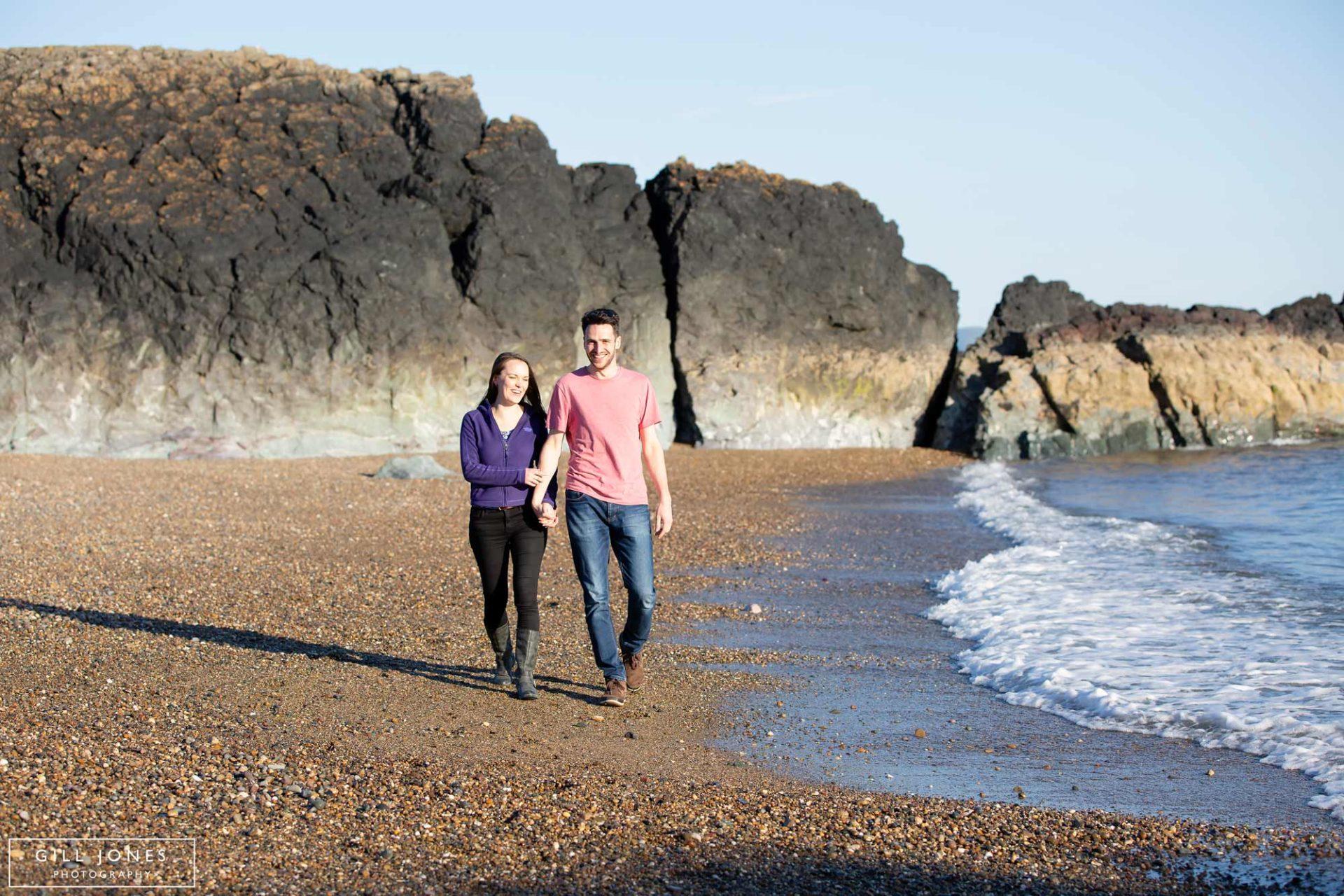 a couple walking along the shoreline